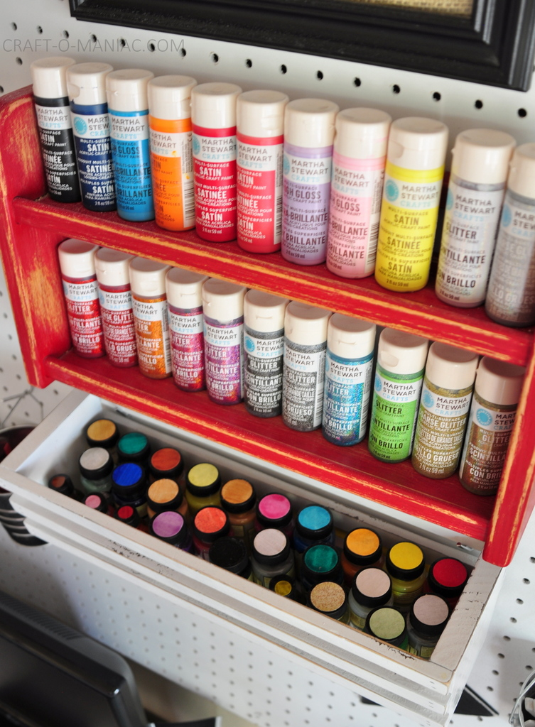 craft room makeover paints on pegboard