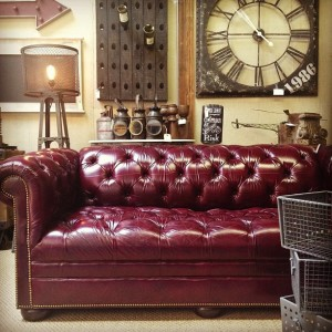 dark leather couch and wall